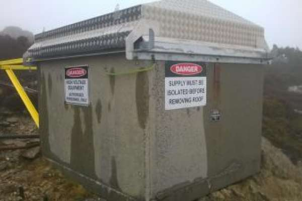 Weather cover for remote electrical housing 1