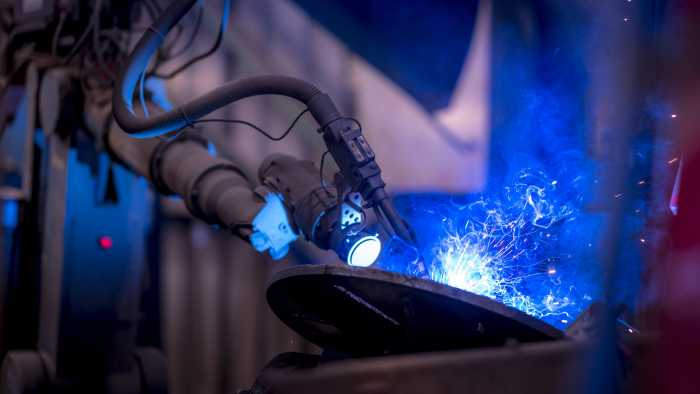Robotic welding station in operation